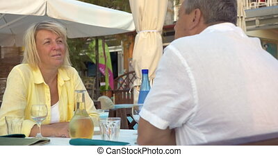 Loving senior couple in street cafe