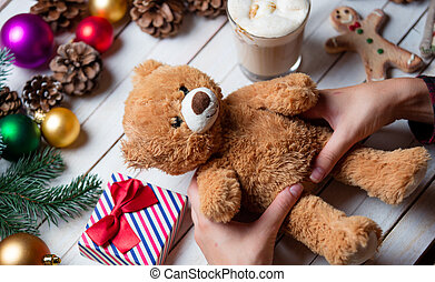 female hand holding a teddy bear - photo of the female hand...