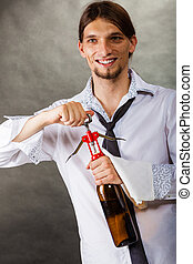 Waiter opens wine bottle - Winery serving tasting alcohol...
