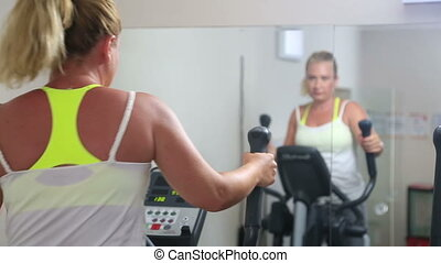 Woman trains on stepper