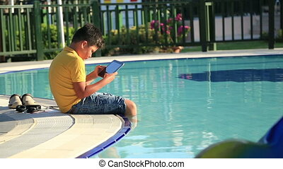 Young boy with earphone - Young boy using digital tablet...