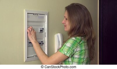 pretty girl turn on circuit breakers and smile at camera....