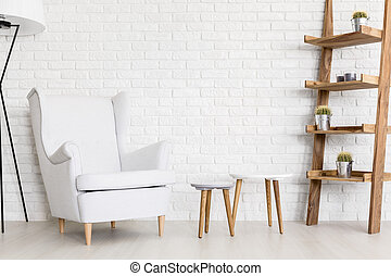 Modern white interior - Shot of a room with a big armchair,...