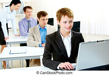 Business training - Portrait of business people typing on...