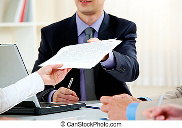 Handing over documents - Close-up of handing over documents...