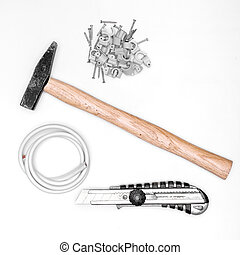 set of tools - hammer, knife , wire and nails on white...