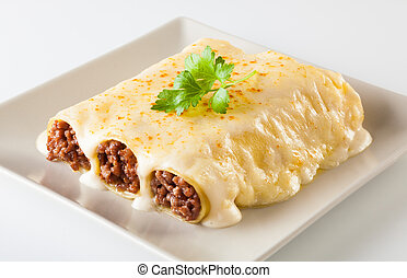 Cannelloni - Delicious meat filled pasta on a plate. Italian...