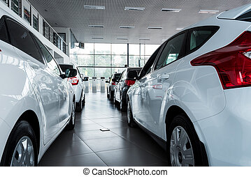 New cars at dealer showroom - Stock of cars in showroom of...