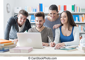Schoolmates studying together - Group of smiling college...