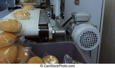 Bread for passengers of plane, packed on conveyor in...
