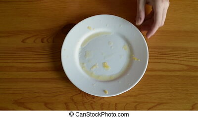 Wiping the plate after oranges on a wooden table.