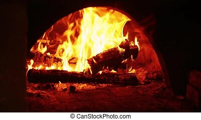 Fire burning in fireplace - Close up of firewood burning in...