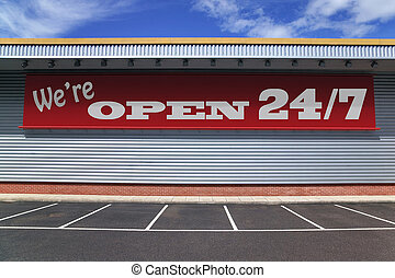 Were open 24 7 - Billboard on a retail building with notice...