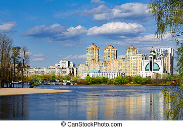 Modern apartment buildings on a river bank