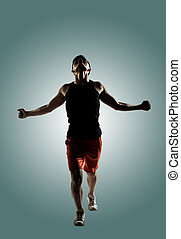 young male athlete - Silhouette of young male athlete, full...