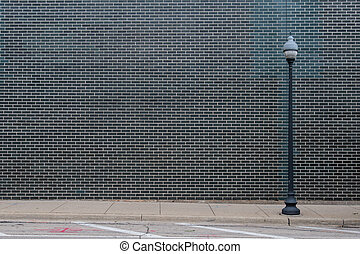 Black Brick Wall With Light Post and copy space