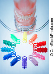 Multicolored ligature ties , facebow and dentures