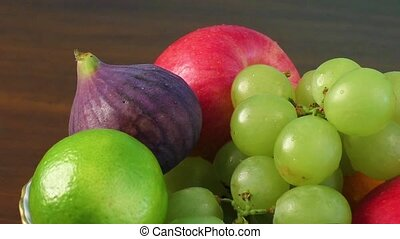Assortment fruits on wooden table
