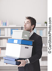 Disappointed businessman carrying boxes - Disappointed...