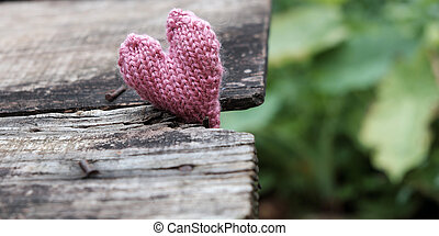 Lonely heart on wooden background