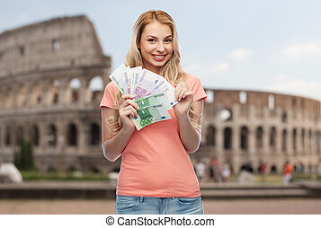 happy young woman with euro cash money - money, finances,...