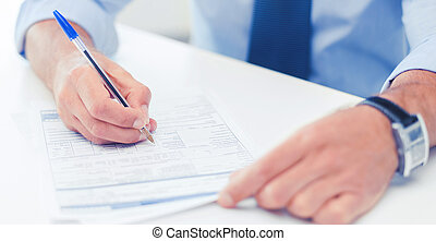 man filling tax form