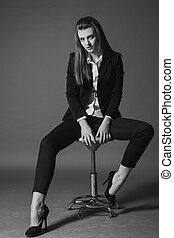 girl model posing in the Studio on a Chair