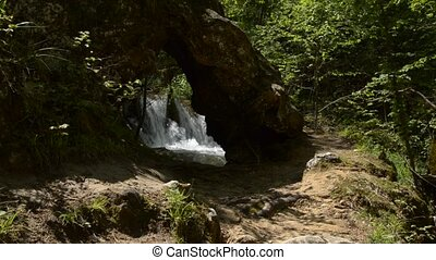 Rapids Through the Rock - Rapids of fast mountain river,...