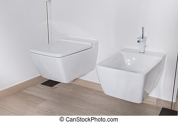 stylish bathroom with bidet and WC in white