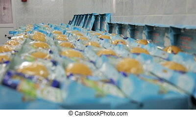 A factory worker flight catering, arranges products in lunch...
