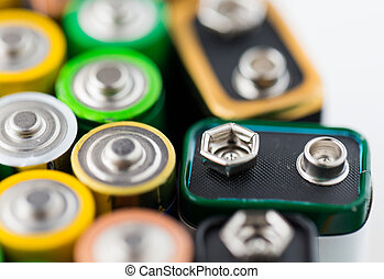 close up of alkaline batteries - recycling, energy, power,...