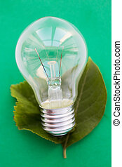close up of bulb or incandescent lamp on green - recycling,...