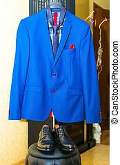 Hanging wedding suit with shoes - Hanging blue wedding suit...