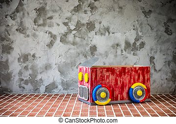 Toy car made of cardboard box Travel and vacation concept