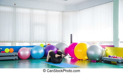 Fit Girl Lying In Relaxation Pose On Exercise Mat - In the...
