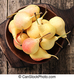 ripe pears on vitage wooden table - sweet ripe pears on...