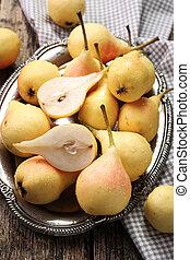 ripe pears on vitage wooden table - sweet ripe pears on...