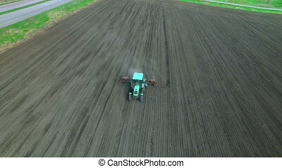 Tractor in a field making fertilizer - Tractor in a field...