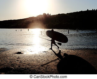 sports and recreation on the water - a man carries in his...