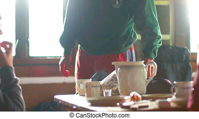People Having Breakfast in the Cabin - Group of Hikers...