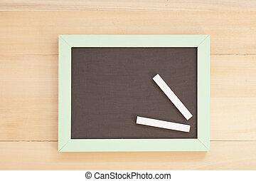 school wooden blank blackboard and white chalks on wooden...