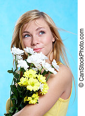 Spring time - Portrait of pretty girl with spring flowers on...
