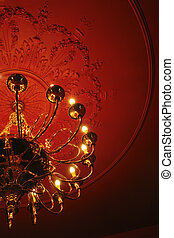 Classic chandelier on the red ceiling
