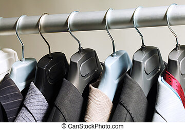 Hangers with suits - Photo of hangers with jackets on them...