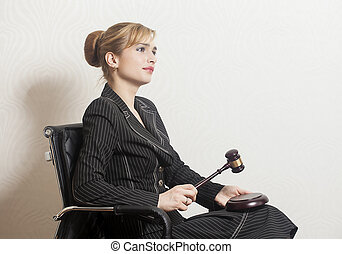 Female Judge With Wooden Gavel in office chair