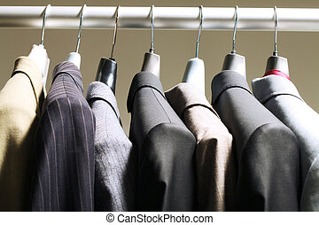 Jackets in wardrobe - Photo of hangers with jackets of...