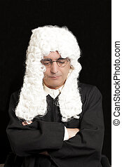 Portrait Of Male Lawyer in a wig with eyeglasses on black background