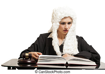 Female judge wearing a wig and black mantle with judge gavel...