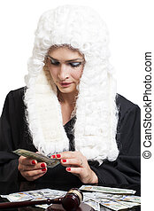 Female corrupt judge counting money at table isolated on...