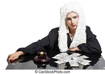 Female corrupt judge with gavel and money at table isolated...